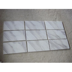 white volakas marble wall panel